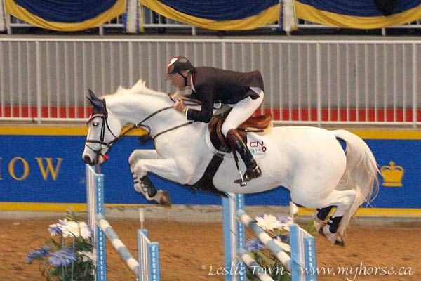 Ian Millar riding Redefin